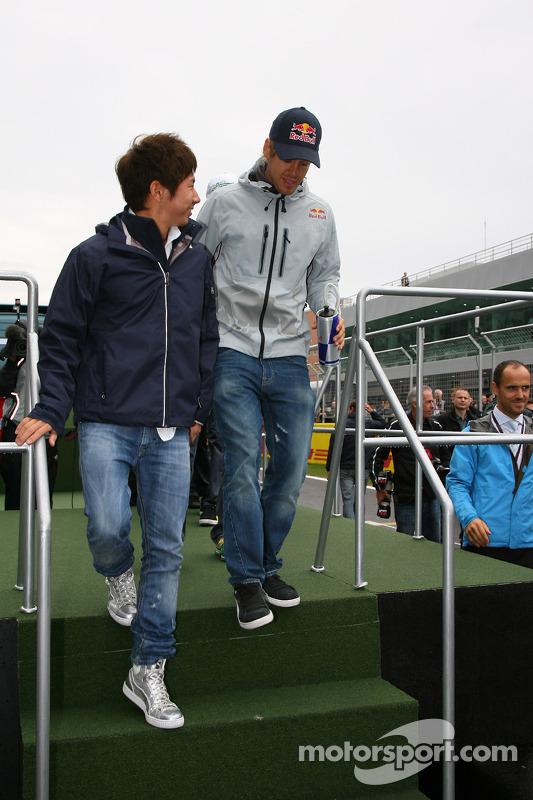 Kamui Kobayashi, BMW Sauber F1 Team en Sebastian Vettel, Red Bull Racing