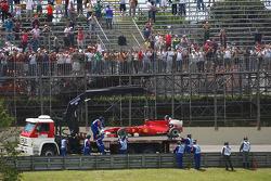 Fernando Alonso, Scuderia Ferrari car is taken back to the pits