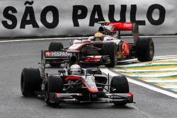 Christian Klien, Hispania Racing F1 Team leads Lewis Hamilton, McLaren Mercedes