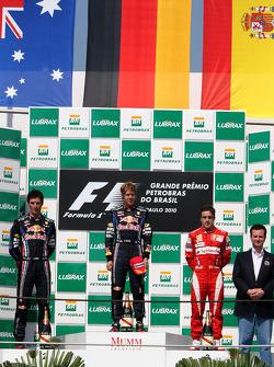 Podium: race winner Sebastian Vettel, Red Bull Racing, second place Mark Webber, Red Bull Racing, third place Fernando Alonso, Scuderia Ferrari