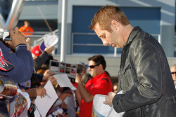 Greg Biffle and Tony Stewart sign autographs
