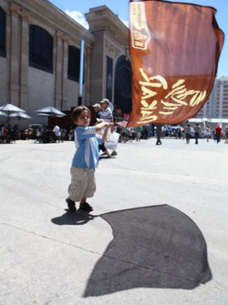 A young fan waits for the start