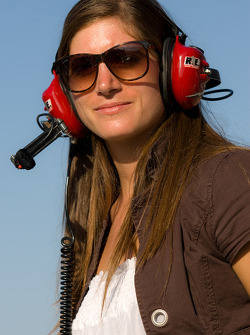 Swiss race car driver Cyndie Allemann watches Nationwide series qualifying