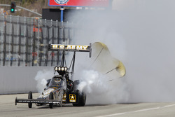 Tony Schumacher oiling down the track during round three of qualifying during the Kragen Oreilly Auto Parts NHRA Winternationals