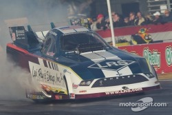 Tim Wilkerson doing a burnout in his Levi, Ray & Sharp Ford Mustang