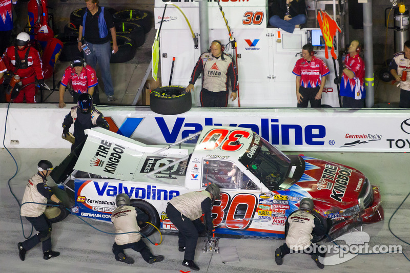 Todd Bodine, Germain Racing Toyota in the pits for damage repair