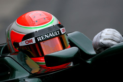 Jarno Trulli, Team Lotus, uses the new Bell helmet with the carbon part on top of the visor, new 2011 FIA helmet regulation