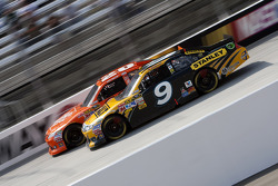 Marcos Ambrose, Petty Motorsport Ford and Joey Logano, Joe Gibbs Racing Toyota