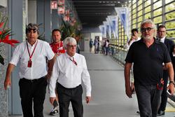 Pasquale Lattuneddu della FOM con Bernie Ecclestone e Flavio Briatore