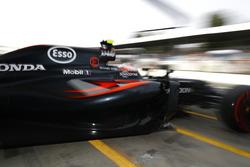 Jenson Button, McLaren exits the pit garage