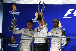 Race winner Nico Rosberg, Mercedes AMG F1 (Left) with third placed team mate Lewis Hamilton, Mercedes AMG F1 (Right) on the podium