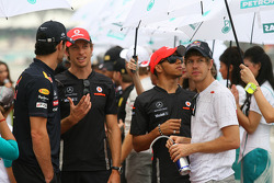Mark Webber, Red Bull Racing with Jenson Button, McLaren Mercedes and Sebastian Vettel, Red Bull Racing