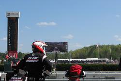 Team Penske members wait for the start
