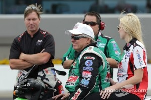 John Force surrounded by Mike Neff, Dean Antonelli and daughter Cortney Force