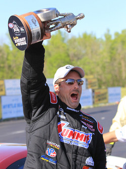 Greg Anderson celebrates winning the Pro Stock catagory