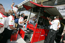 Newman Haas Racing crew members celebrate pole position