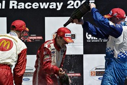 Cristiano da Matta, Sébastien Bourdais and Paul Tracy on the victory podium