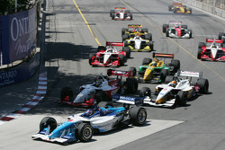 First turn: Paul Tracy leads the field behind Sébastien Bourdais