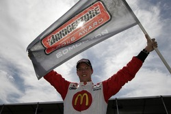 Sébastien Bourdais celebrates winning the pole position