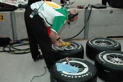 Ganassi Racing crew member prepares tires