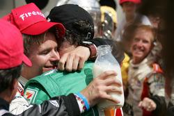 Victory lane: race winner Dan Wheldon celebrates