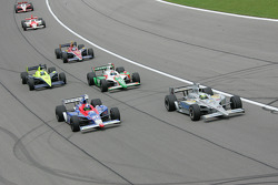 Tomas Scheckter and Dario Franchitti lead a group of cars