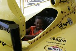 A young fan tries racing sim
