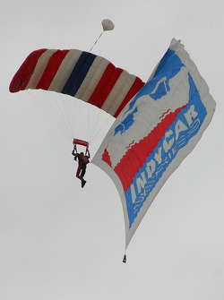 Skydivers arrive with the flags