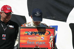 Dan Wheldon admires his new trophy