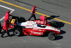 Ganassi Racing crew members push car to pitlane