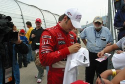 Sam Hornish Jr. signs autographs for young fans