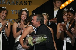 Indy 500 Champion Johnny Rutherford, center, congratulates 500 Queen, Danielle Sylvester