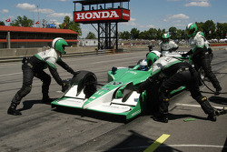 A wing adjustment during the pit stop for Ed Carpenter