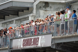 Fans line the balconies to catch a glimps of their favorite driver