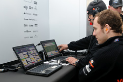 McLaren engineers monitor telemetry while warming up the car