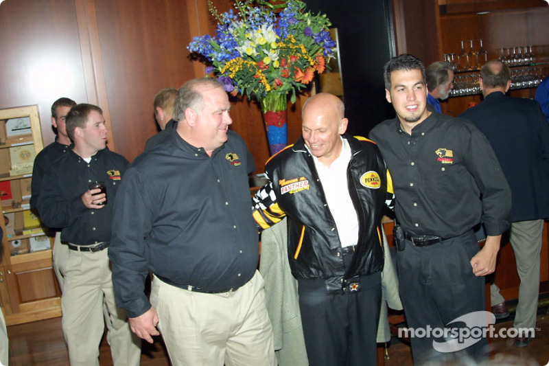 Panther Racing's, John Barnes and Sam Hornish Jr. embrace Pennzoil CEO Jim Postl