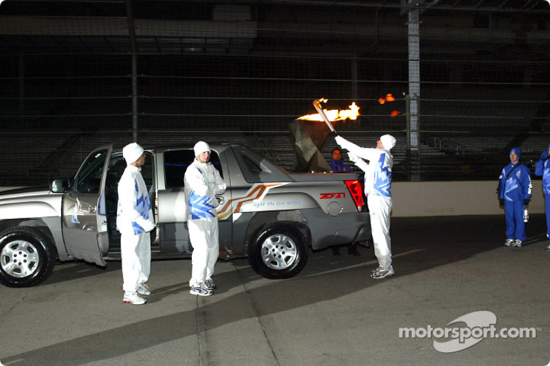 Tony George lights torch in preparation for drive around the famous circuit