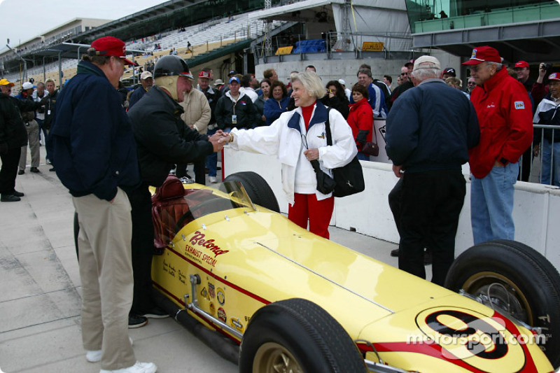 The famous Belond Special was driven to a first place finish in the 1957 500 by Sam Hanks; Hank's wife, Alice, shakes Johnny Rutherford's hand