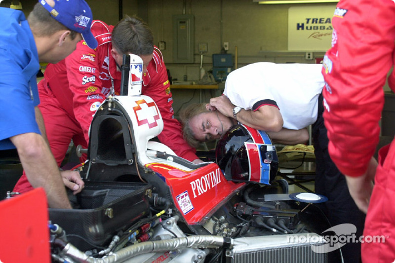 Arie Luyendyk listening to the tuning of his car