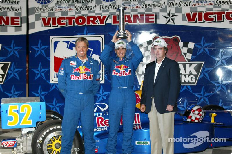 Pole winner Tomas Scheckter with team owner Eddie Cheever
