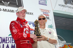 Race winner Scott Dixon accepts trophy