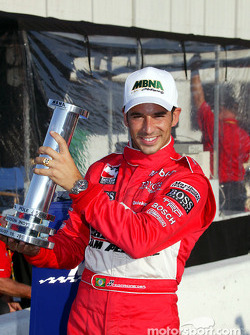 Pole winner Helio Castroneves poses with MBNA pole award