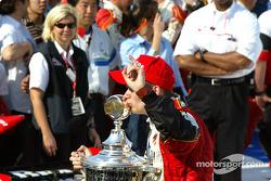 Dan Wheldon poses with the winner's trophy