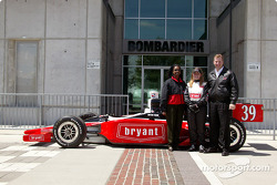Sarah Fisher is surrounded by Bryant marketing manager Debbie Castro and brand manager John Gibbons at the reveal of her Indy challenger