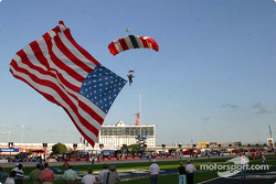 The American flag arrives during pre-race ceremonies