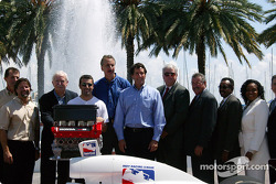 Barry Green, Michael Andretti, Dario Franchitti and Tony George pose with St. Petersburg representatives