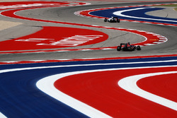 Даниил Квят, Scuderia Toro Rosso STR11, и Валттери Боттас, Williams FW38