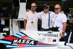 Felipe Massa, with his father Luis Antonio Massa, (Right) and brother Dudu Massa, with a specially liveried Williams FW38 marking his retirement from F1