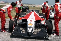 Checking tires on Vasser's car