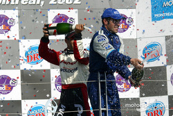 The podium: champagne for Dario Franchitti and Tony Kanaan